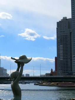 Statue overlooking the water at Tsukishima