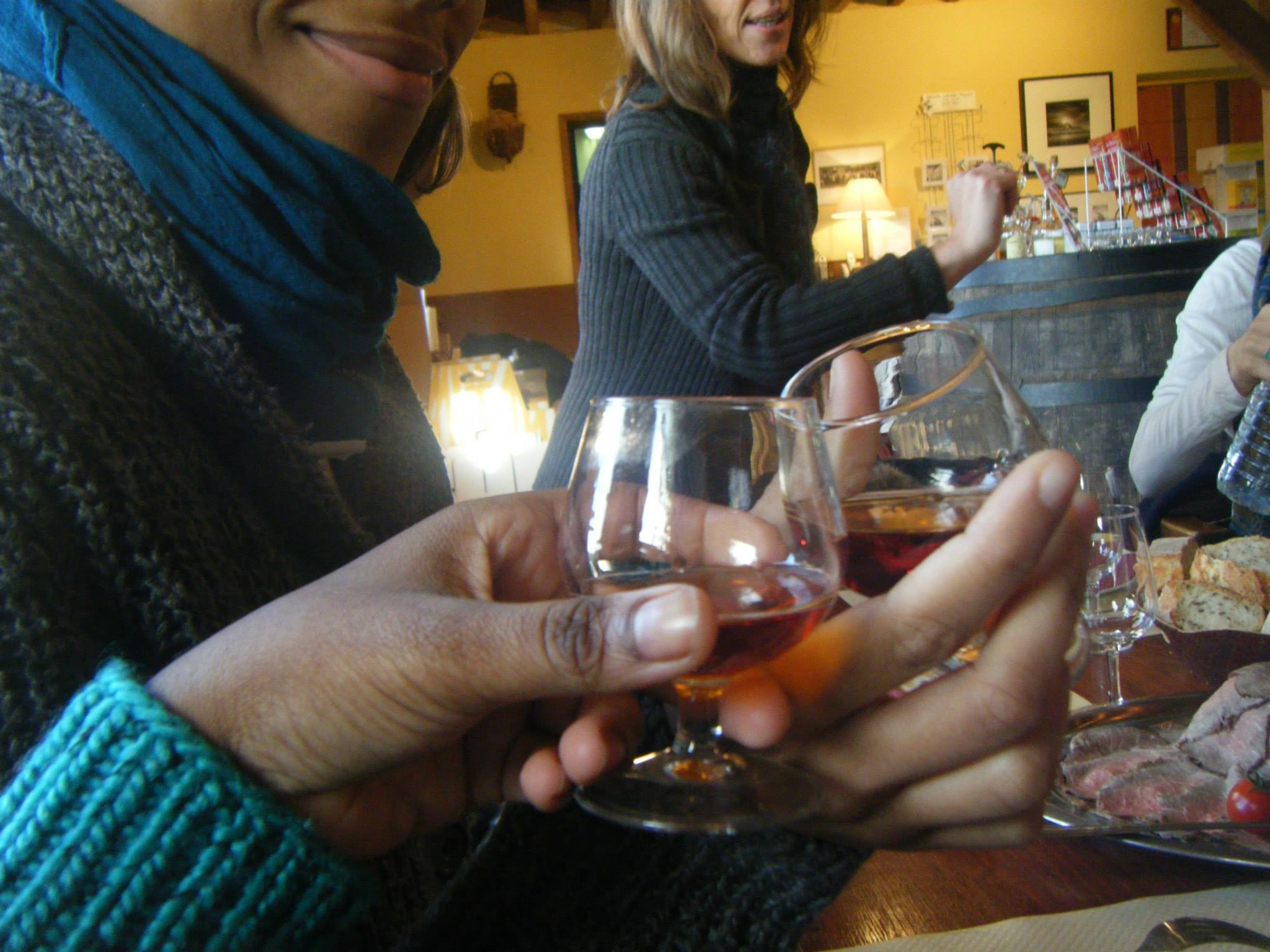 Women toasting with cognac glasses in the countryside of France