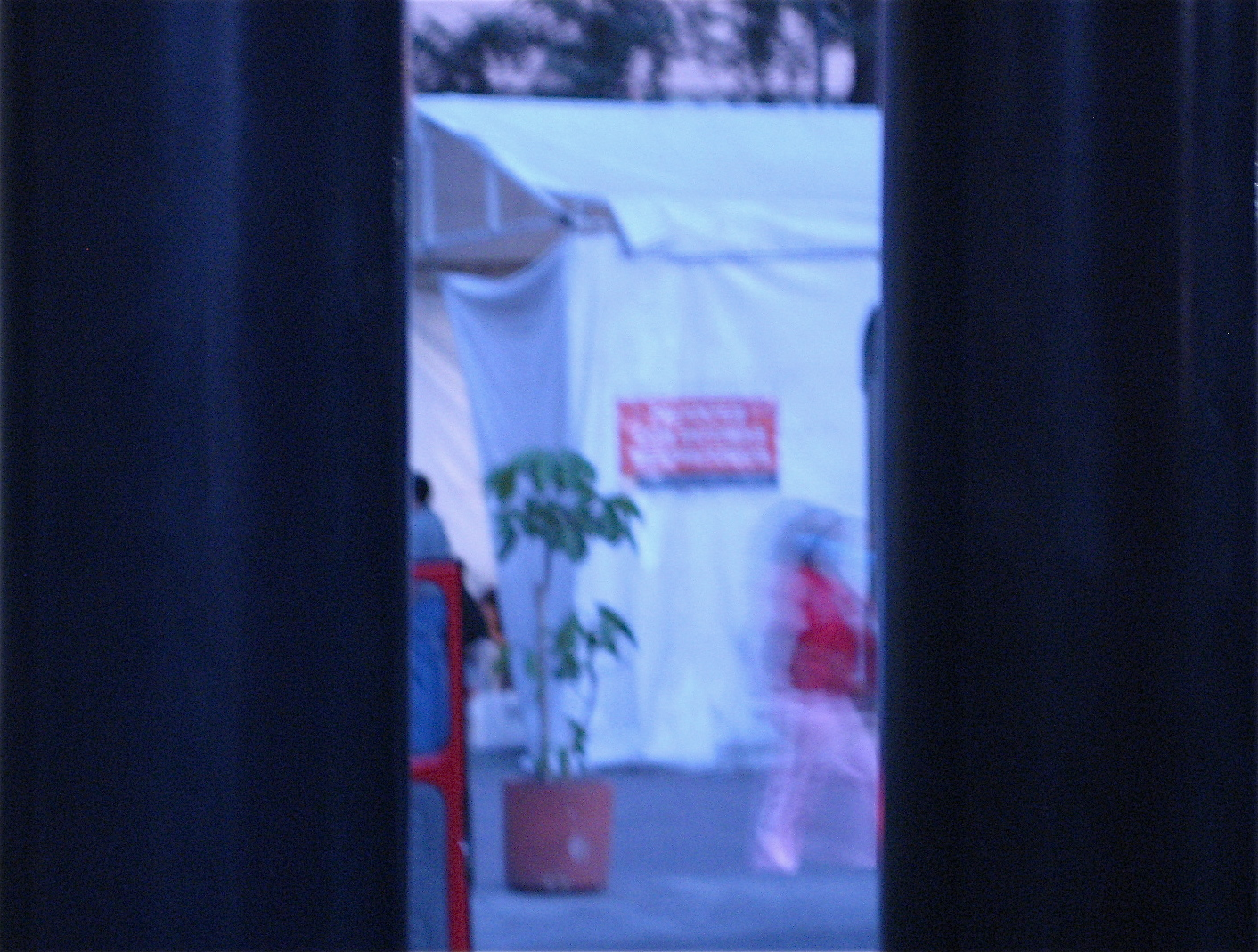 TRIAGE: There was a tent in a court yard in between the hospital entrance and the waiting room. The red sign on the tent said respiratory patients only.