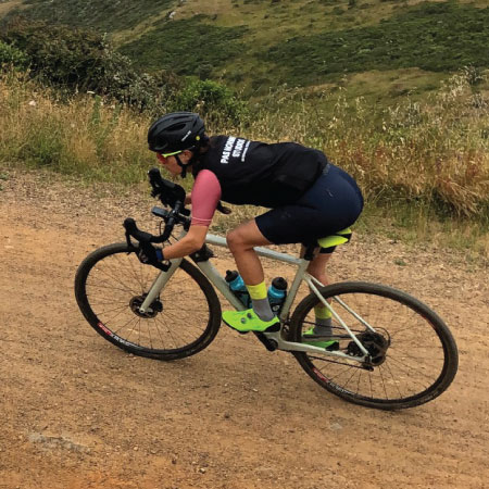 aerial view of Libby Caldwell riding on gravel