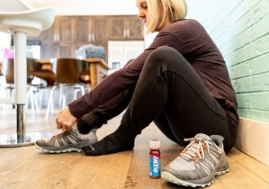 Pam lacing up for a run with an iKOR Recovery Shot