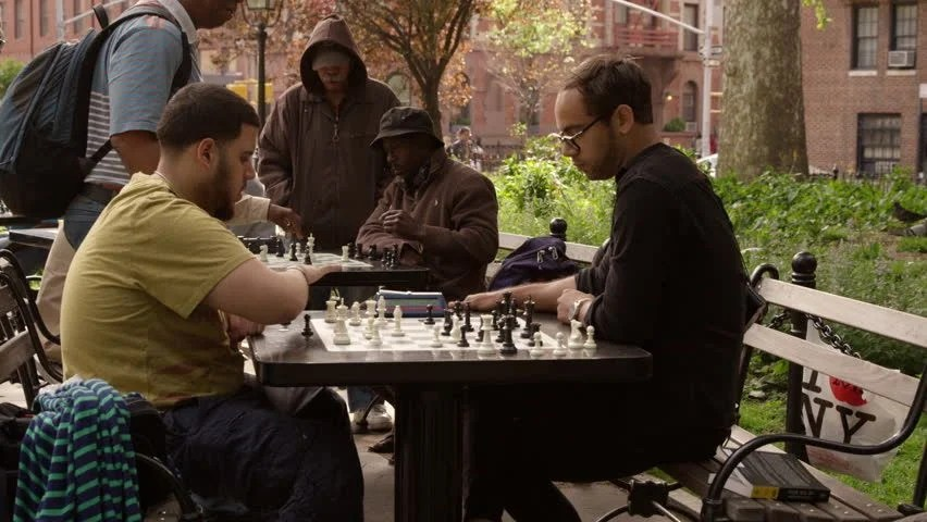 People playing chess in a park