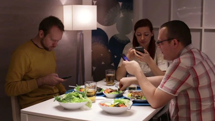 Image result for couple smartphone dinner