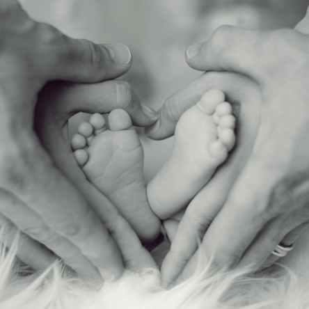 newborn feet mum dad hands post partum winter