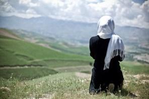 A woman praying during a short break while on a travel in Badakhshan