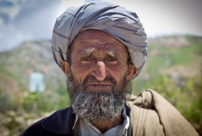 A man traveling on foot between villages in the Hindu Kush