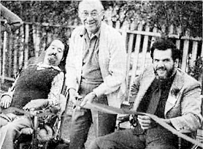 Black and white picture from 1976 ILCSC Ribbon-cutting Ceremony. Ed Roberts in wheelchair, Past Director of California Department of Rehabilitation; Ernandi Bernardi, Los Angeles Councilman; and Darrell Mc Daniel, Co-Founder, Internal Revenue Service Counselor.