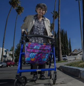Norma Jean Vescovo walks next to the handicapped curb painted blue as a result of her efforts.