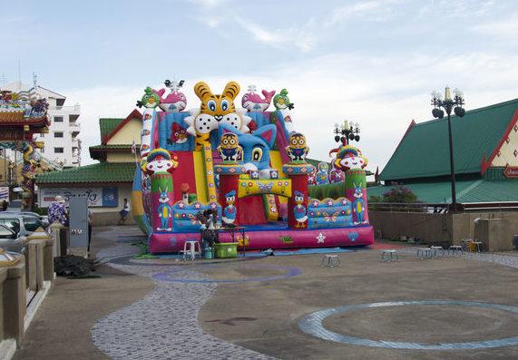 Asian thai children relax playing on inflatable playground or inflatable toy in playground at Tha Nam Non market on July 26, 2016 in Nonthaburi, Thailand
