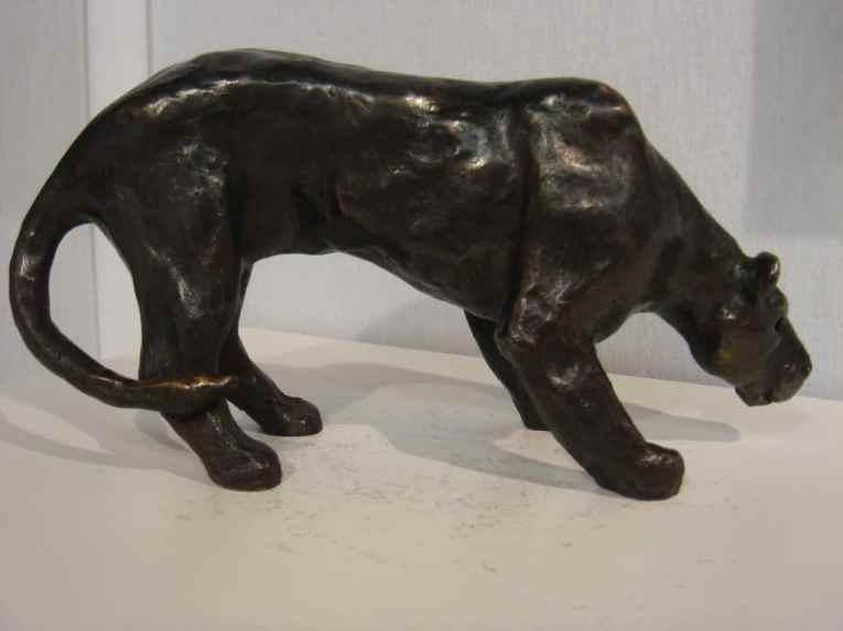 Lioness, lying in wait, bronze