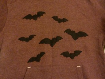 Felt bats appliqued on to a hoodie