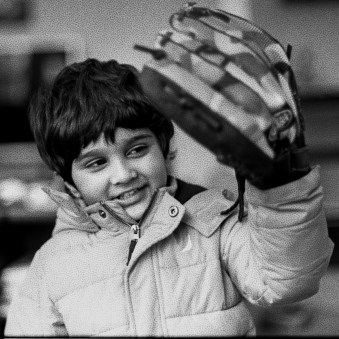 Black and white image of boy with reticulated glove