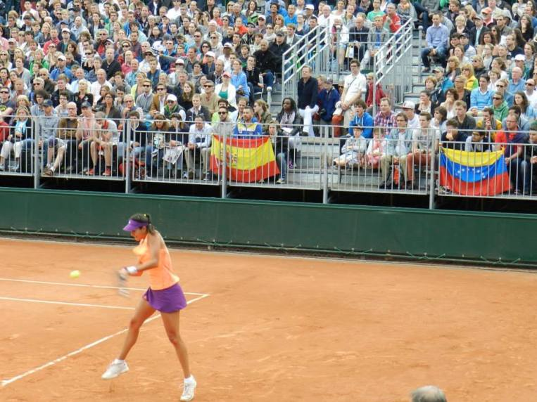 Spanish and Venezuelan flags during a match at Roland Garros 2014