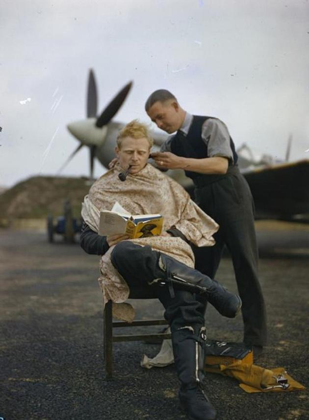 RAF pilot getting a haircut between missions