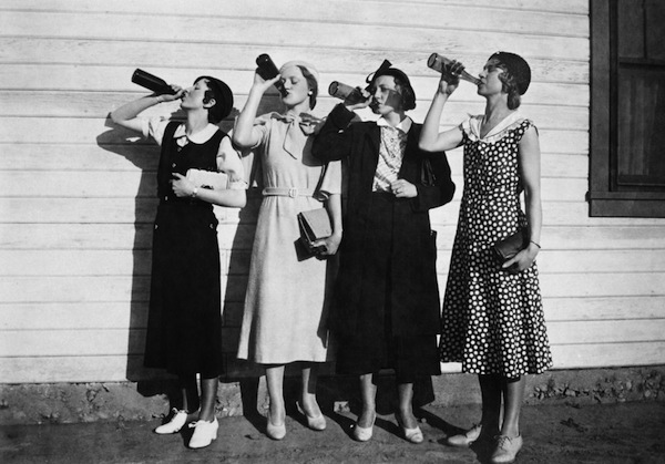 flappers drink bootleg alcohol in unison