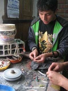 Jewelry artisan in Cusco (Cuzco), Peru