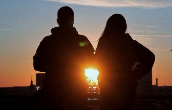 Sunset over two people