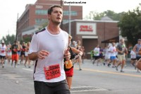Cardiac Hill hath no mercy - a runner out at the Peachtree Road Race in Atlanta