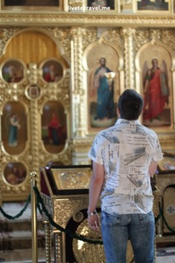Person praying at the Metropolitan Cathedral in Chisinau, Moldova