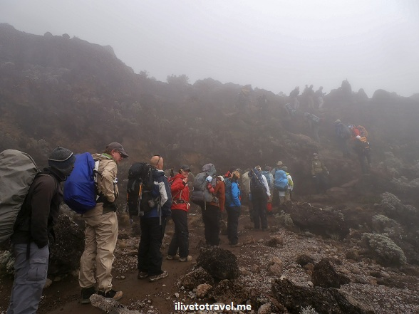 Rain hits while climbing Mt. Kilimanjaro in Tanzania