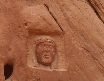 carving Lawrence of Arabia's face in Barrah Siq Wadi Rum Jordan desert outdoors Olympus