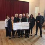 Members of Ilkeston Breathe Easy Group receiving a cheque from Councillors Mary …