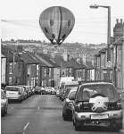 A picture from our archives.  A ladybird-shaped hot air balloon descends rather ...