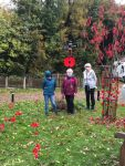 Members of Shipley WI keeping up the tradition of decorating the village with kn...