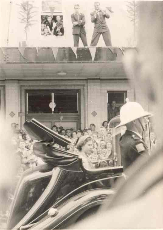 Queen Elizabeth driving through streets