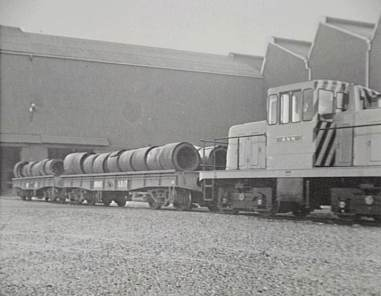 P07742 - John Lysaght (Australia) Ltd - The first hot strip coils rolled on the Hot Strip Mill entering the storage building at the Springhill Works - 1955