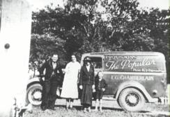 "Edward George Chamberlain's van used for ""The Popular"" cafe and provision shop which was located on the corner of Lawrence Hargrave Drive and McCauley Street, Thirroul. Rube Chamberlain and friends standing in front of the van - P16395"