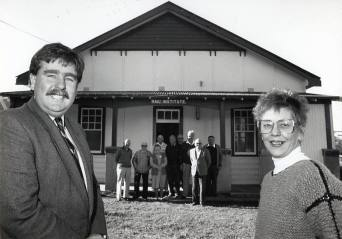 P21545 - Wollongong Ald. David Campbell and Rail Institute Trustee member Lois Hagan joined by concerned community members in the fight to retain the historic Thirroul building, 11 August 1989