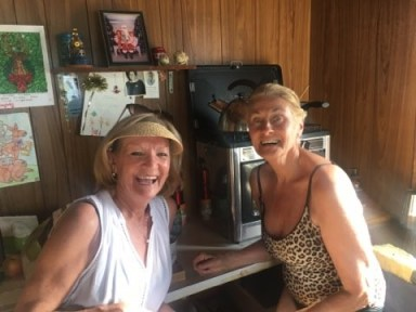 Helen and her cousin Marilyn inside the shack