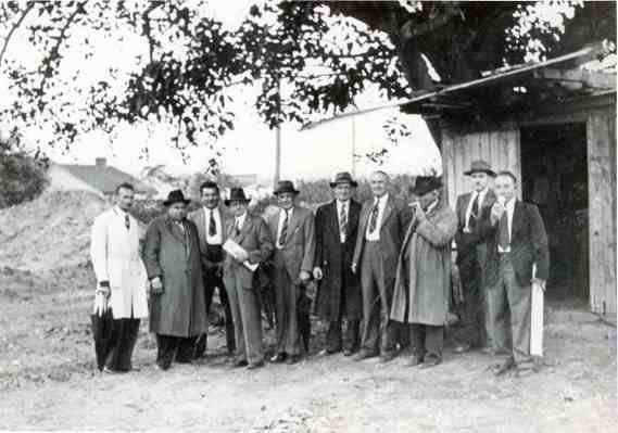 P21495 - Turning the first sod at the Turrella (N.S.W.) factory for Streets Ice Cream Pty. Ltd. Pictured (left to right): R. Orchard, E. Jones, J. Shepherd, N. Guest, W. Eggins, Edwin Street, C. Lusk, P. Caro, K. Inglis, R. England.