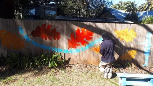 Painting the Oak Tree mural