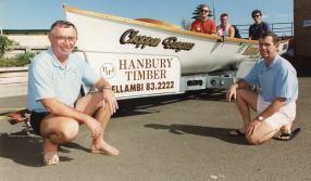 P27216 - Towradgi Surf Club's new boat trailer with (from left) President Terry Steddman, Greg Lancaster, Graeme Eagleton, Tom Cartwright (in boat) and Graham Davis of Altek Marine - 26 November 1992