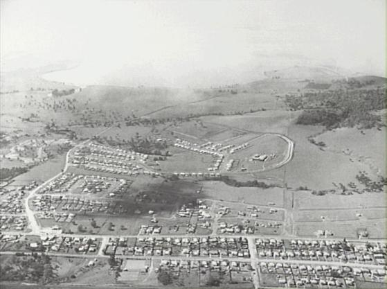 P15146 - Aerial photograph of Dapto looking east, 1961