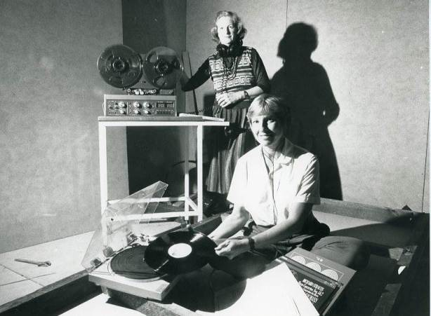 P24457 - 2 Vox-FM station manager Kathy Cox (front) and announcer Nola Dunne in the room of the group's Ellen Street premises which is to become the station's studio, 18 June, 1986
