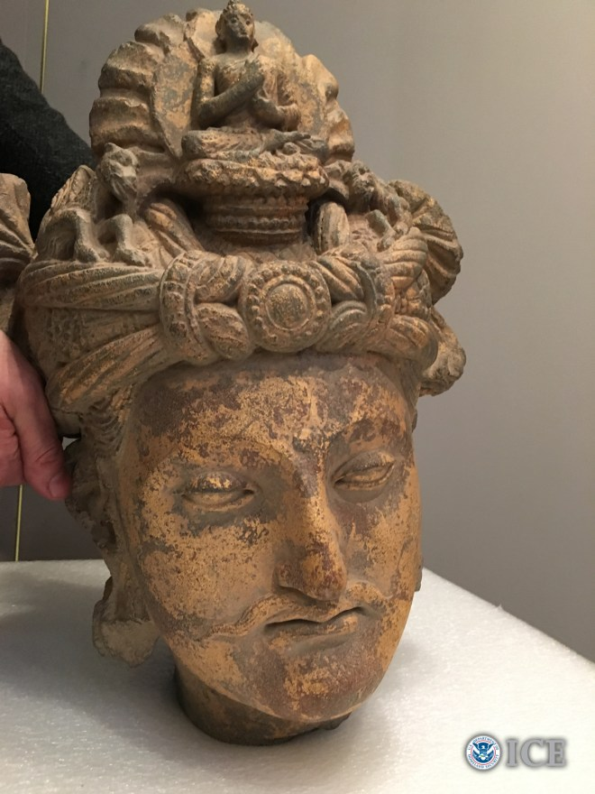 Image from ICE, CBP, This seizure contained a 2nd Century Bodhisattva schist head from the Gandhara region (likely from what is now known today as Swat Valley, Pakistan,) and is estimated to be worth hundreds of thousands of dollars.