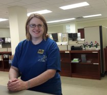 """Tris Bennett has worked at the library for 17 years. Laid off from her previous job, she took the job at the library and has stayed ever since. """"I just kind of fell into it,"""" Bennett said."""