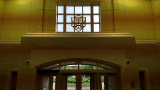 Light filters through the windows of the front entrance hall of the Booth Library.