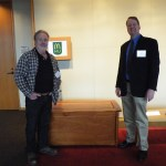 Wade Ellis, left, First Place Furniture, for his Cherry Chest, with John Lough, chair of the Urban Wood Products Showcase.