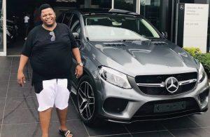 Dladla Mshunqisi purchases a Mercedes Benz automobile