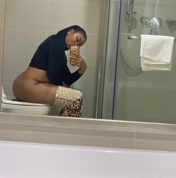 Actress Etinosa sitting on the toilet
