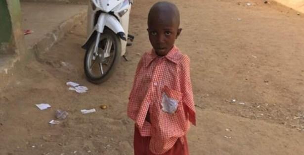 Meet Umar Abdullahi, 4-year old armless Nigerian schoolboy who writes with his toes