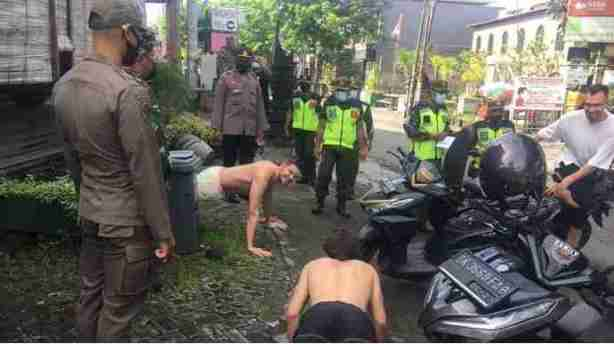 RIGHT OR…? See How Foreigners Without Face Masks Were Punished With Push-Ups In Indonesia