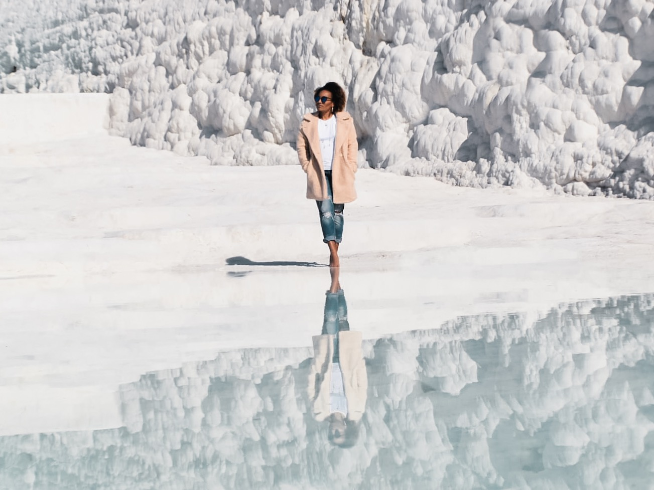 Illustrated by Sade - Photo of me and my reflection in the water standing in the hot spring water terrace at Pamukkale, Turkey.