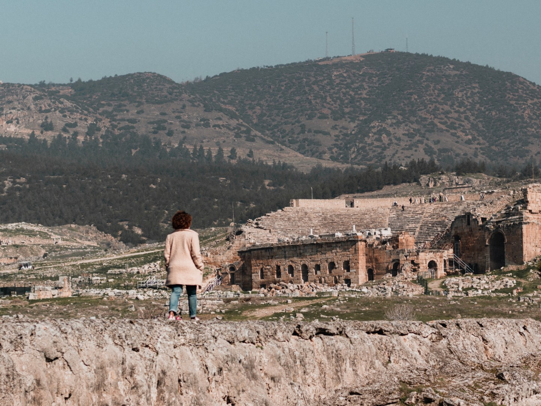 Illustrated by Sade - Walking along the ruins of Hieropolis Amphitheater at Pamukkale, Turkey