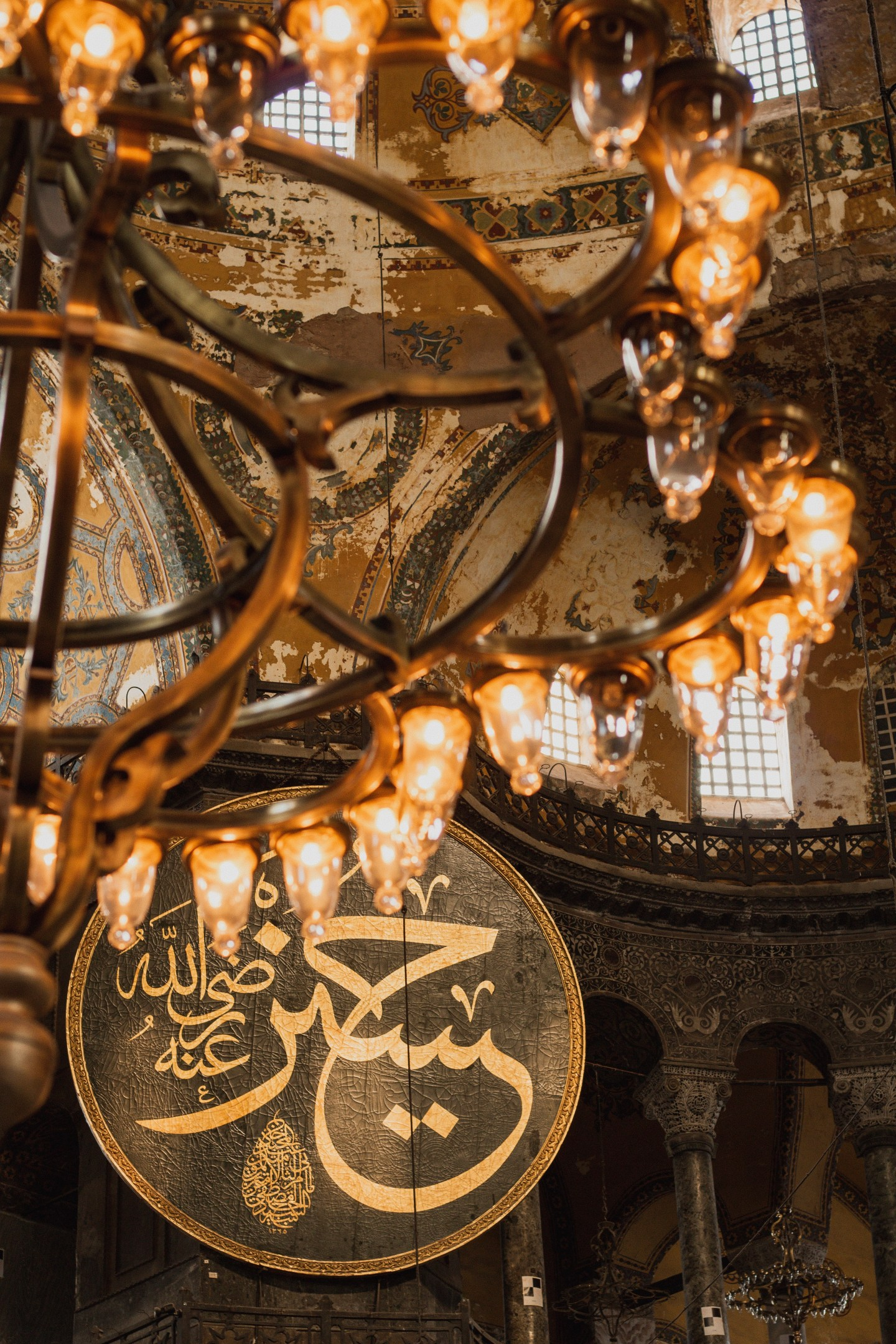Illustrated by Sade - Ornate chandelier inside of Hagia Sophia Mosque in Istanbul, Turkey