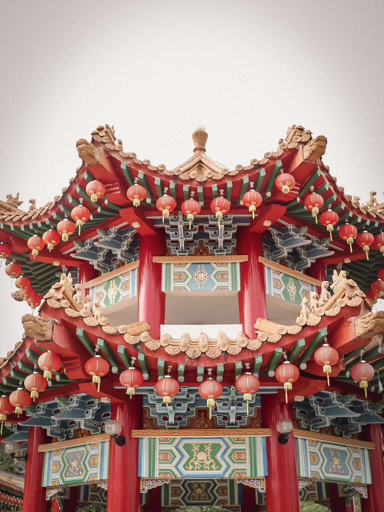 Illustrated by Sade - Colorful red, blue and yellow ornate roof at Thean Hou Temple.